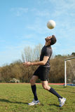Soccer Player Juggle The Ball With His Head Stock Photography