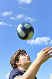 Soccer player juggling ball Stock Photos