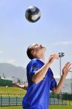 Soccer player juggling ball Stock Photos