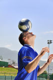 Soccer player juggling ball Stock Images