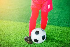Soccer player jump and stomp for training Stock Photo