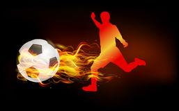 Soccer player kicked the fire ball. Soccer player playing the ball with hot fire Royalty Free Stock Photos