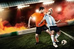 Soccer player kicked to the face other player. Soccer player kicked an elbow to the face other player at the stadium. Not fair play royalty free stock photo