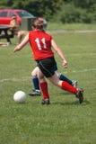 Soccer Player Kicking Ball 2. Girl soccer player kicking ball during game play Stock Image