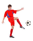 Soccer player kicking the ball Stock Image