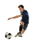 Soccer Player Kicking Ball Royalty Free Stock Photos