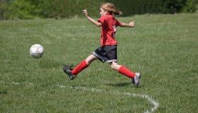 Soccer Player Kicking Ball 4. Girl soccer player kicking ball during game play Stock Image