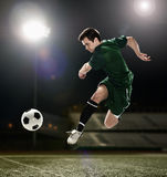 Soccer player kicking the ball Royalty Free Stock Photo