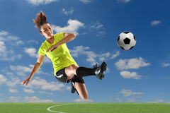 Soccer Player Kicking Ball. Female soccer player kicking ball outdoors royalty free stock photos