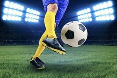 Soccer player kicking the ball Royalty Free Stock Photos
