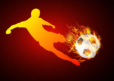 Soccer player kicking ball fire. Soccer player kicking with ball fire background Stock Photos