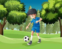A soccer player kicking the ball Royalty Free Stock Image