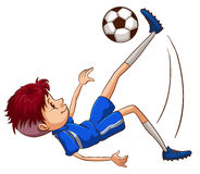 A soccer player kicking the ball Stock Photos