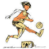 Soccer Player Kicking Ball. An image of a soccer player kicking the ball with goalie in background Royalty Free Stock Image