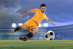 Soccer Player Kicking Ball Royalty Free Stock Photos