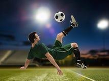 Soccer Player Kicking the ball Stock Photo