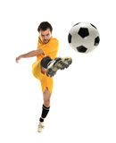 Soccer Player kicking the ball Royalty Free Stock Photos