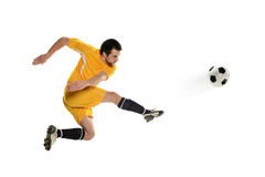 Soccer player kicking the ball Royalty Free Stock Photography