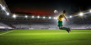 Soccer player kicking ball . Mixed media Stock Image