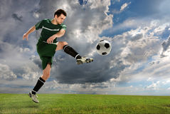 Soccer Player Kicking Ball Outdoors Stock Image