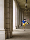 Soccer Player Kicking Ball In Portico Stock Photos