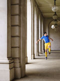 Soccer Player Kicking Ball In Portico Royalty Free Stock Image