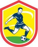 Soccer Player Kicking Ball Retro Stock Photos