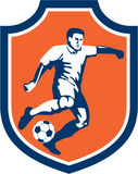 Soccer Player Kicking Ball Shield Retro Royalty Free Stock Images