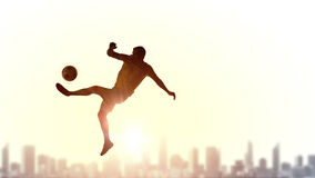 Soccer player kicking ball Stock Photos