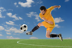 Soccer Player Kicking Ball Royalty Free Stock Photography