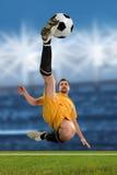 Soccer Player Kicking Ball stock image