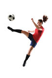 Soccer Player Kicking Ball. Young soccer player kicking ball isolated over white background royalty free stock photography