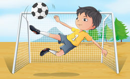 A soccer player kicking a soccer ball Royalty Free Stock Photo