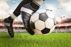 Soccer player kicking soccer ball in motion Stock Images