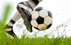 Soccer player kicking soccer ball in motion. 3d rendering soccer player kicking soccer ball in motion Stock Image