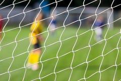 Soccer player kicks the ball Royalty Free Stock Image