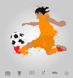Soccer player kicks the ball with paint splatter design Royalty Free Stock Photos