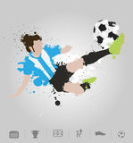 Soccer player kicks the ball with paint splatter design Stock Image
