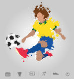 Soccer player kicks the ball with paint splatter design Stock Photography