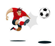 Soccer player kicks the ball Royalty Free Stock Photography