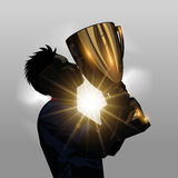 Soccer player kissing trophy. Silhouette soccer player kissing gold trophy with gray background Stock Photography