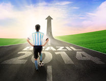 Soccer player leading to football competition. Back view of soccer player standing with a soccer ball leading to football competition in brazil Stock Photos