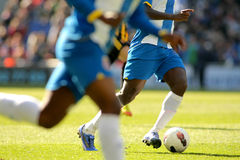Soccer player legs Stock Images