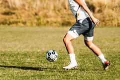 Soccer player legs in action Stock Photo