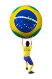 Soccer player lifting a big soccer ball Royalty Free Stock Photography