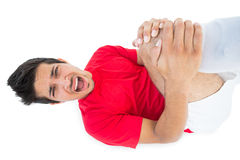 Soccer player lying down and shouting in pain Royalty Free Stock Photos