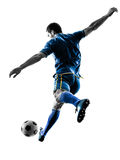 Soccer player man kicking silhouette isolated. One caucasian soccer player man playing kicking in silhouette isolated on white background stock images