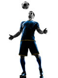 Soccer player man silhouette isolated. One caucasian soccer player man playing in silhouette isolated on white background Royalty Free Stock Image