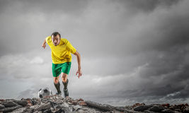 Soccer player outdoors . Mixed media Stock Photography