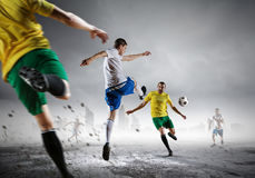 Soccer player outdoors . Mixed media Stock Images